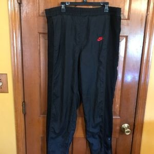 EUC Nike Flight XL pants with mesh up the sides.